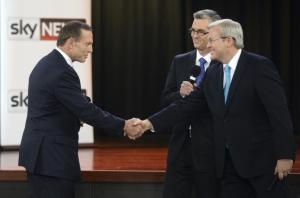 Prime Minister Kevin Rudd and Coalition Leader Tony Abbott shake hands after the People's Forum